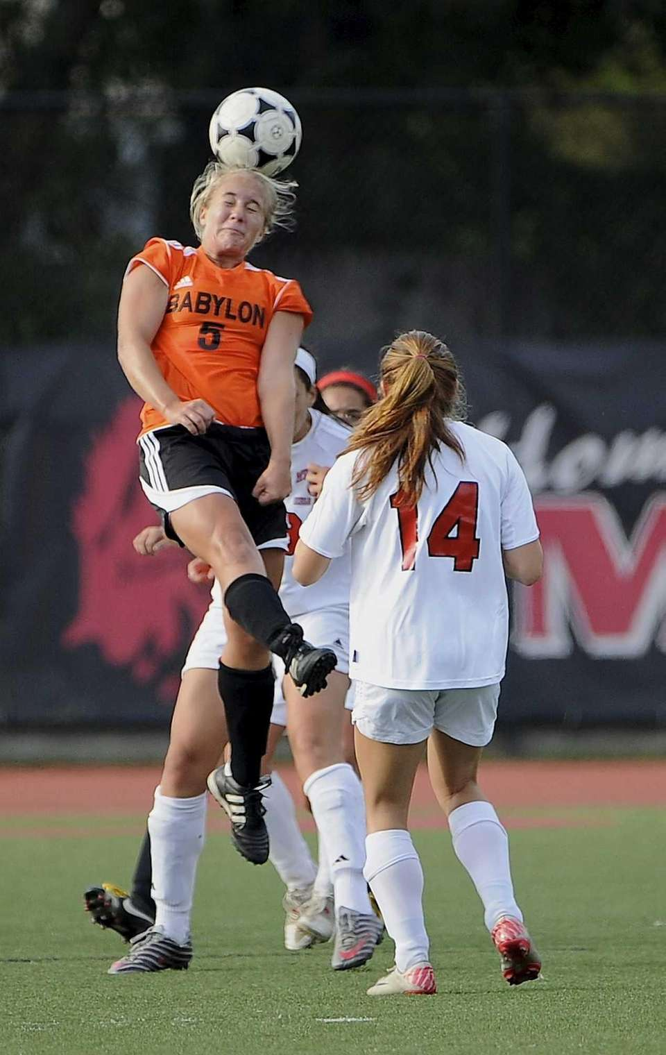 Babylon's Shelby Fredericks heads the ball in a