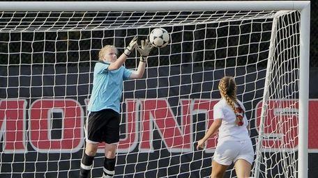 Babylon goalkeeper Hannah McGlinchey makes a save on