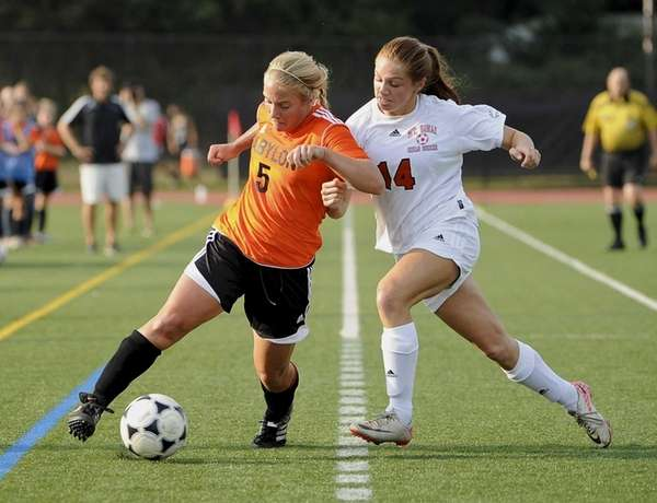Babylon's Shelby Fredericks controls the ball defended by