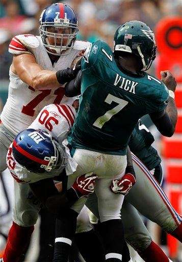 Philadelphia Eagles quarterback Michael Vick is hit by