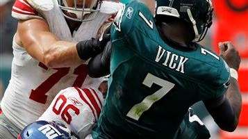 Philadelphia Eagles quarterback Michael Vick is hit by