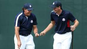 Phil Mickelson exchanges money with Keegan Bradley during