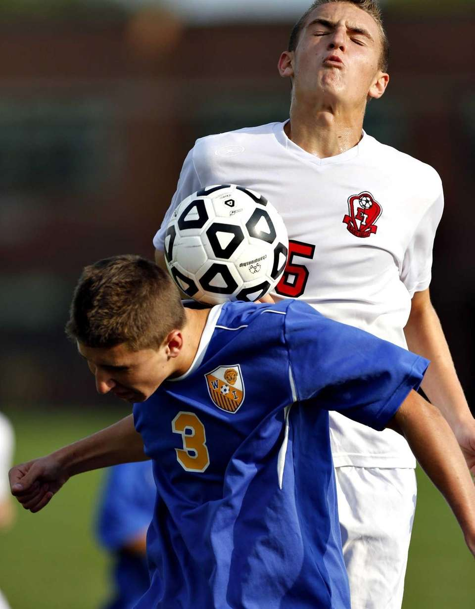 West Islip's Frank Sharp battles East Islip's Andrew