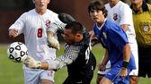 East Islip goalie Frank Noviello dives to knock