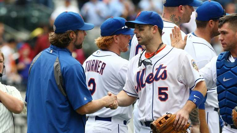 R.A. Dickey and David Wright celebrate after defeating