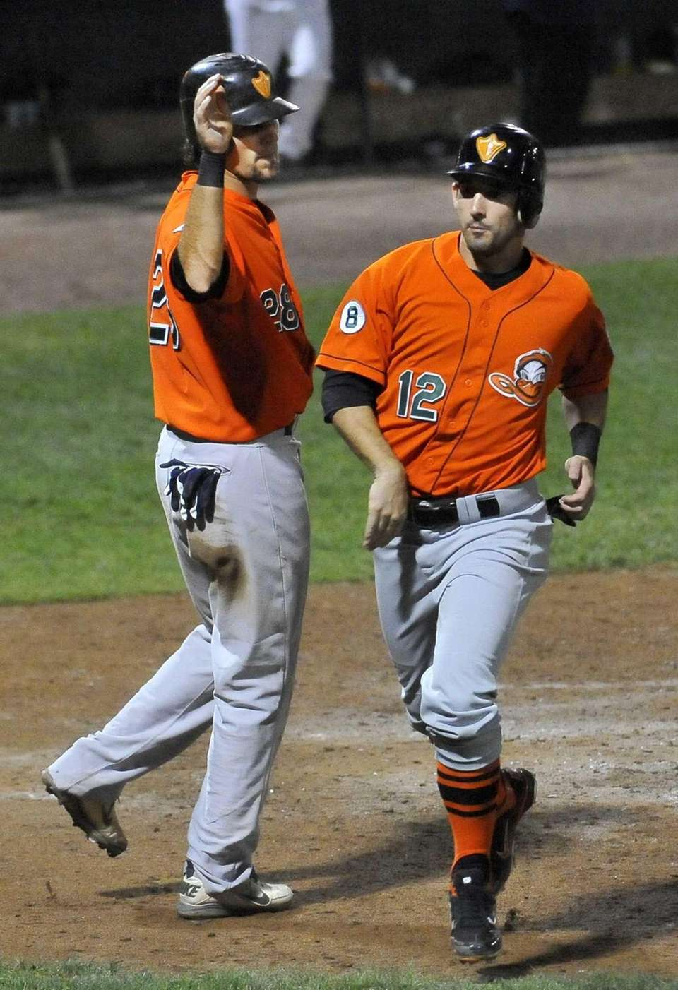 The Long Island Ducks' Mitch Canham is greeted