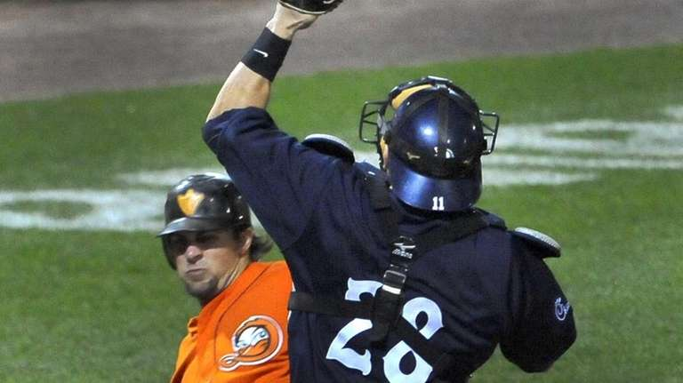 The Long Island Ducks' Mitch Canham slides safely