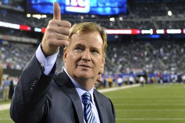Commissioner Roger Goodell gestures to fans before a