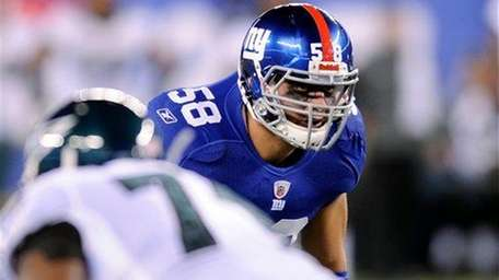 Mark Herzlich lines up during the first quarter