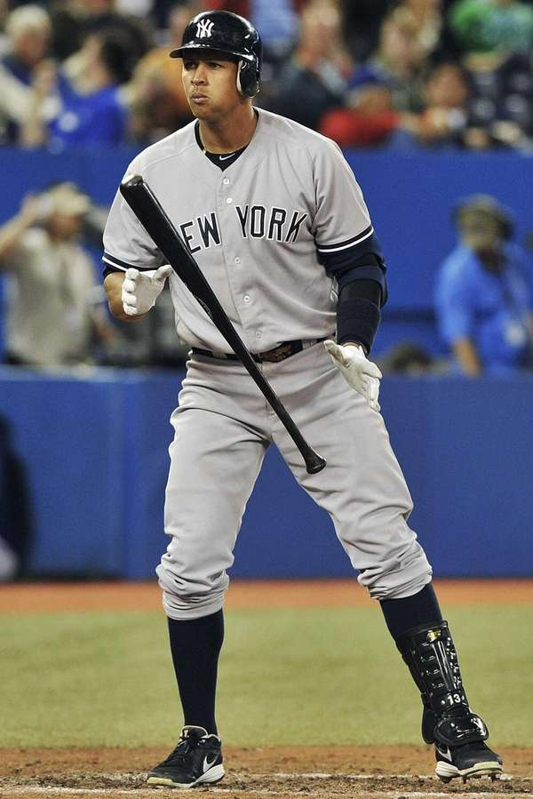 Alex Rodriguez stands at the plate after swinging