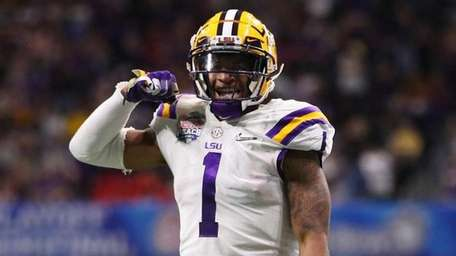 LSU cornerback Kristian Fulton celebrates against Oklahoma safety