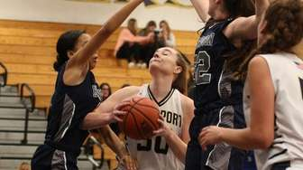 Kerry Dennin of Northport looks for an opening