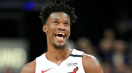 Jimmy Butler of the Miami Heat reacts after