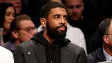 Kyrie Irving of the Brooklyn Nets looks on