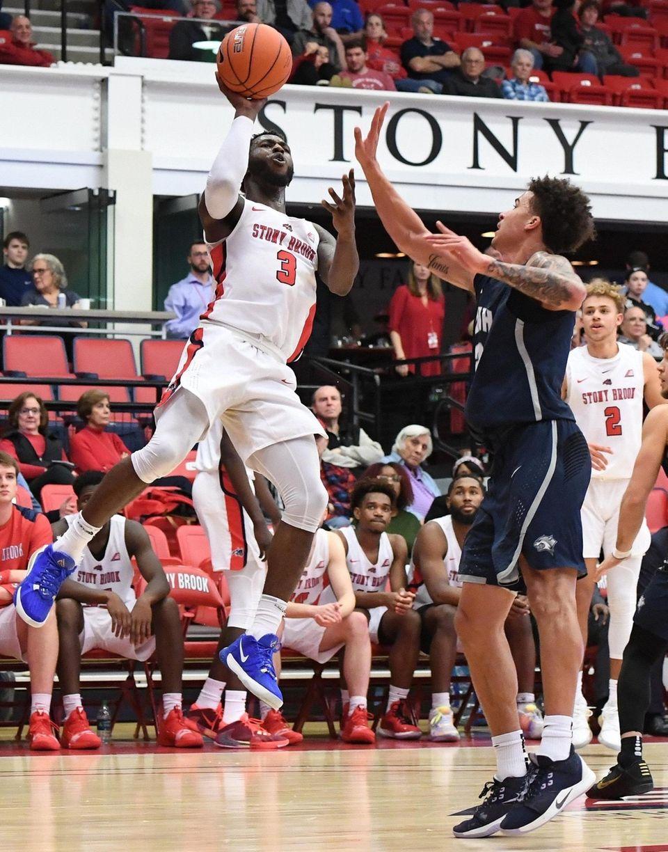 Stony Brook guard Elijah Olaniyi shoots past New