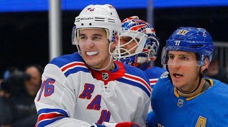 New York Rangers' Brady Skjei, left, and St.