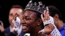 Claressa Shields poses for photographs after defeating Ivana