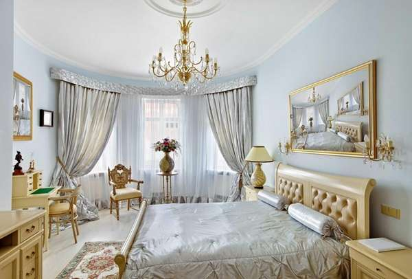 Plush upholstery and billowing curtains create a soft,