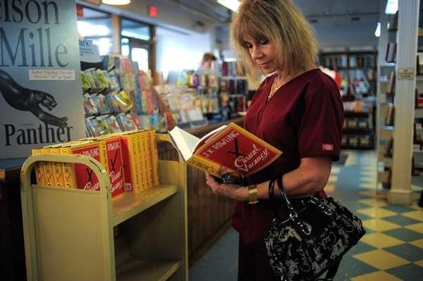 Carol Rothstein, of Greenlawn, thumbs through J.K. Rowling's