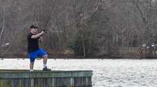 Joe DiPaola, 15, fishes for bass at Belmont