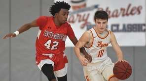 Dayrien Franklin of Center Moriches, left, guards Matthew
