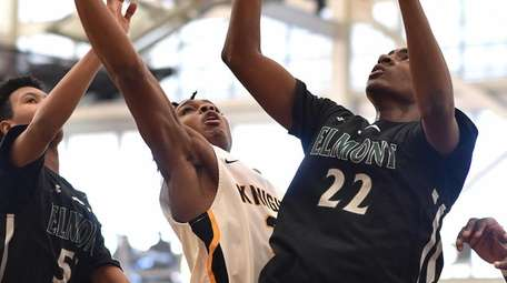 Jayden Freeman of Uniondale, center, battles for a