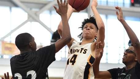Isaiah Joseph-Brock of Uniondale, center, looks to score