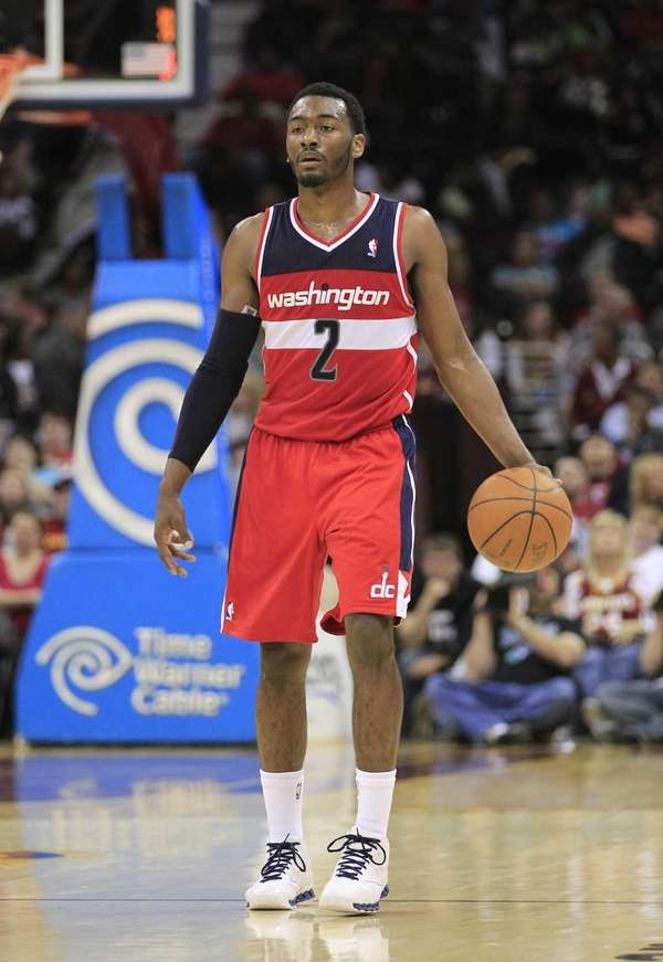 Washington Wizards guard John Wall brings the ball