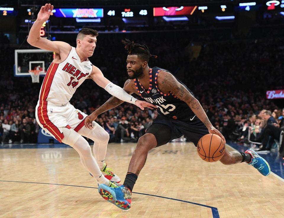 New York Knicks guard Reggie Bullock drives the