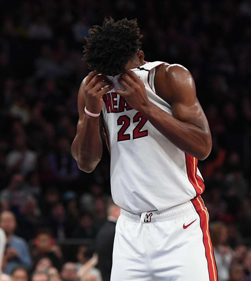 Miami Heat forward Jimmy Butler wipes his face