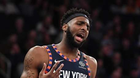 New York Knicks center Mitchell Robinson reacts during