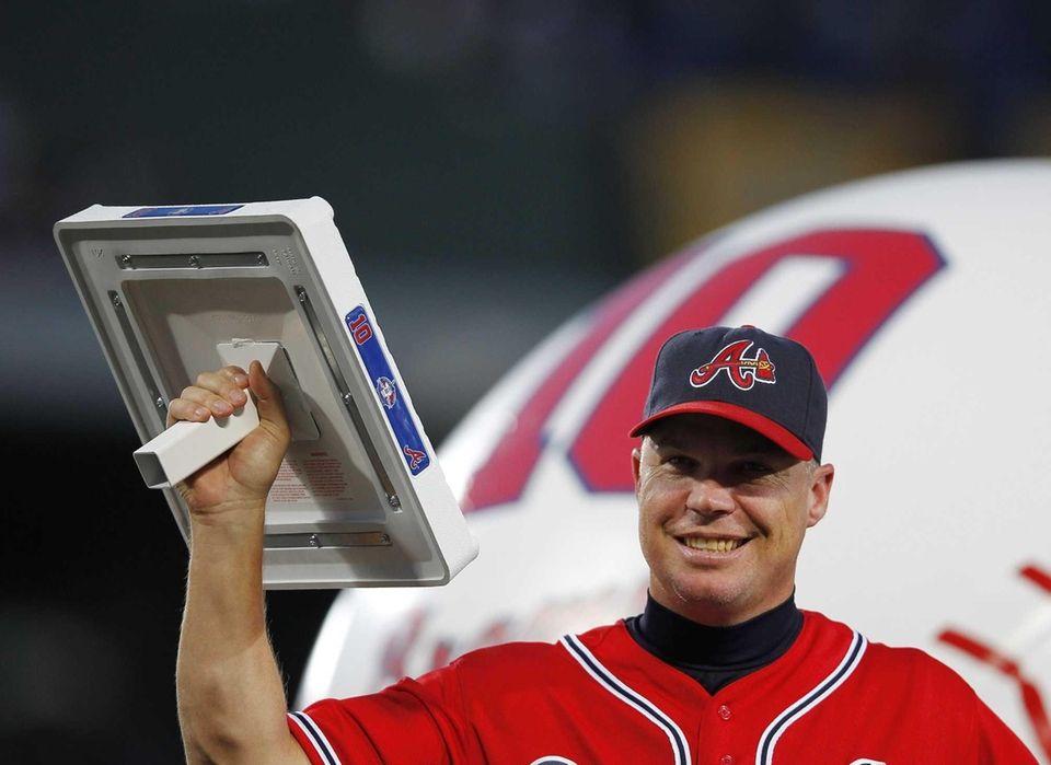 Atlanta Braves third baseman Chipper Jones waves to