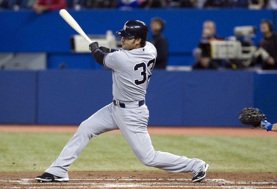 Nick Swisher hits a two-run double off Toronto