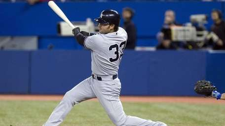 Nick Swisher hits a two-run double off Toronto