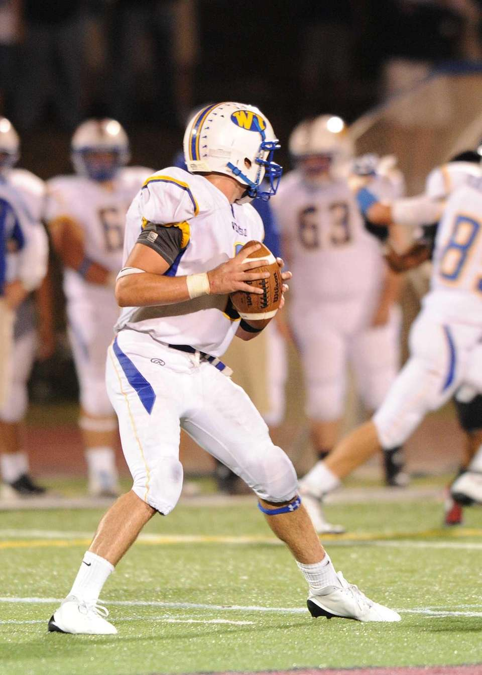 West Islip's Sam Ilario looks to pass downfield