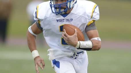West Islip's Sam Ilario runs for the first