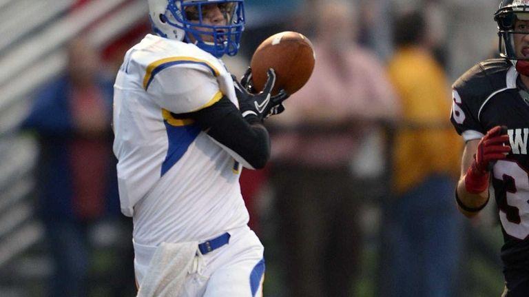West Islip's Ryan Wieczorek makes the catch and