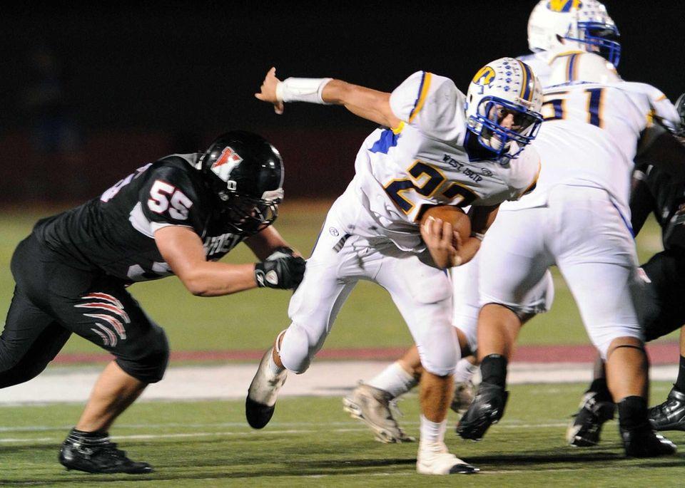 West Islip's Dan Johnson breaks the attempted tackle