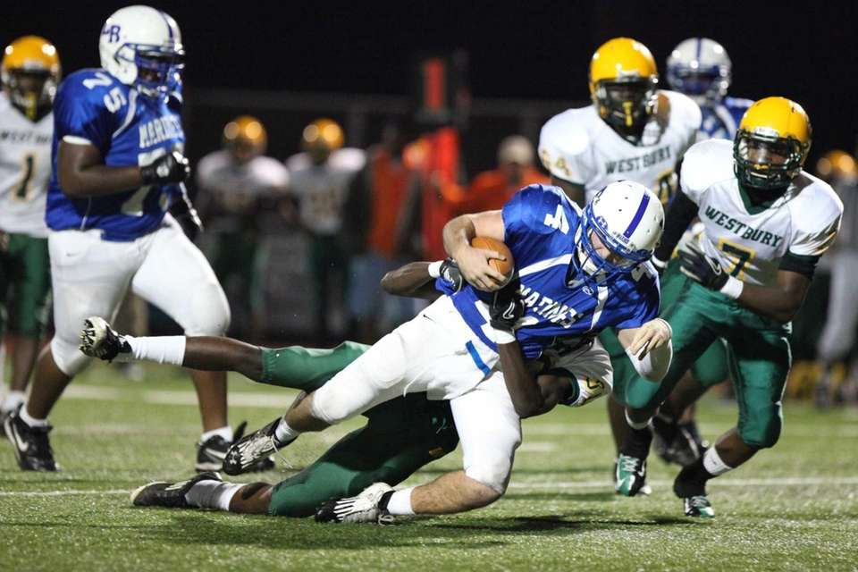 Long Beach's James Forkin is tackled by Westbury's