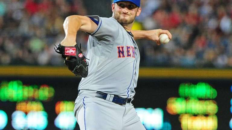 Jon Niese delivers a pitch during a game