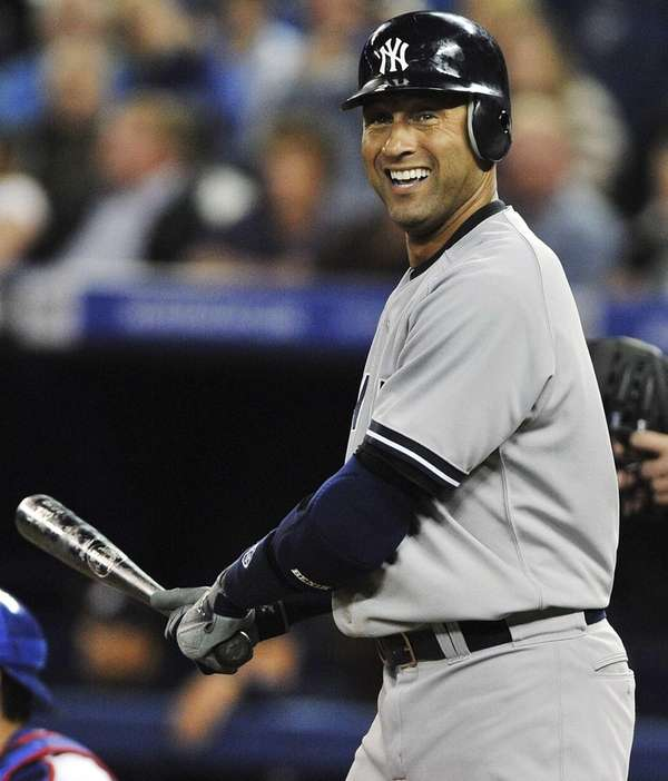 Derek Jeter reacts after swinging at a strike