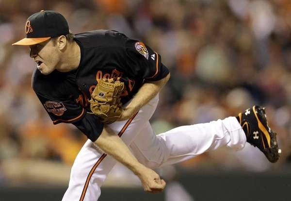 Baltimore Orioles starting pitcher Chris Tillman follows through