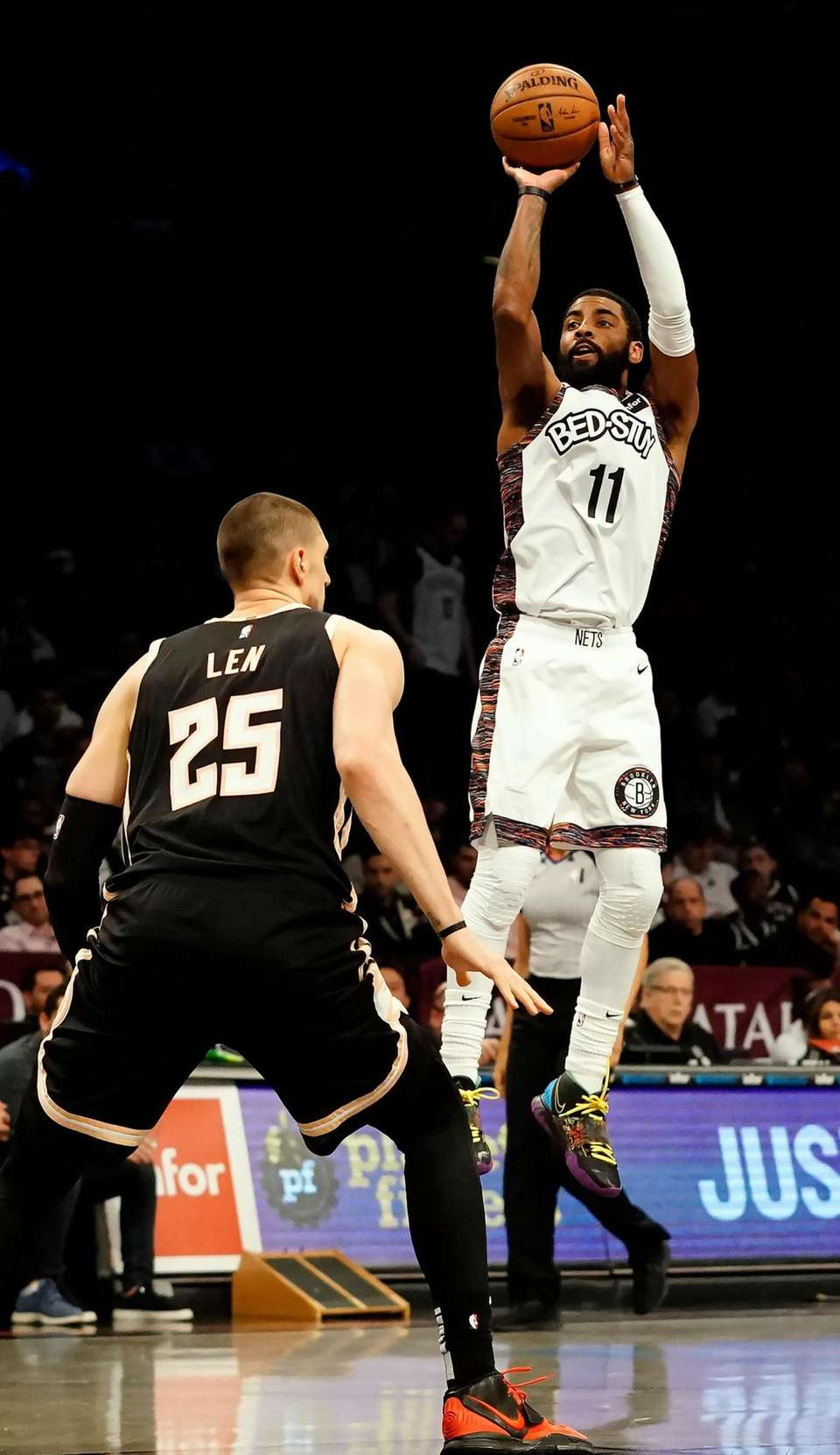 Brooklyn Nets guard Kyrie Irving (11) shoots for