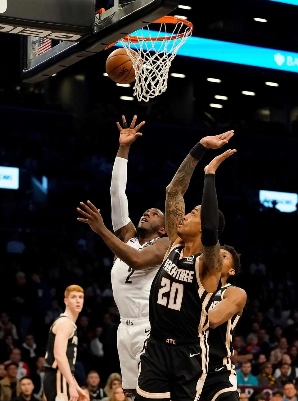Brooklyn Nets forward Taurean Prince (2) goes up