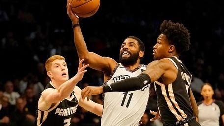 Brooklyn Nets guard Kyrie Irving drives between Atlanta