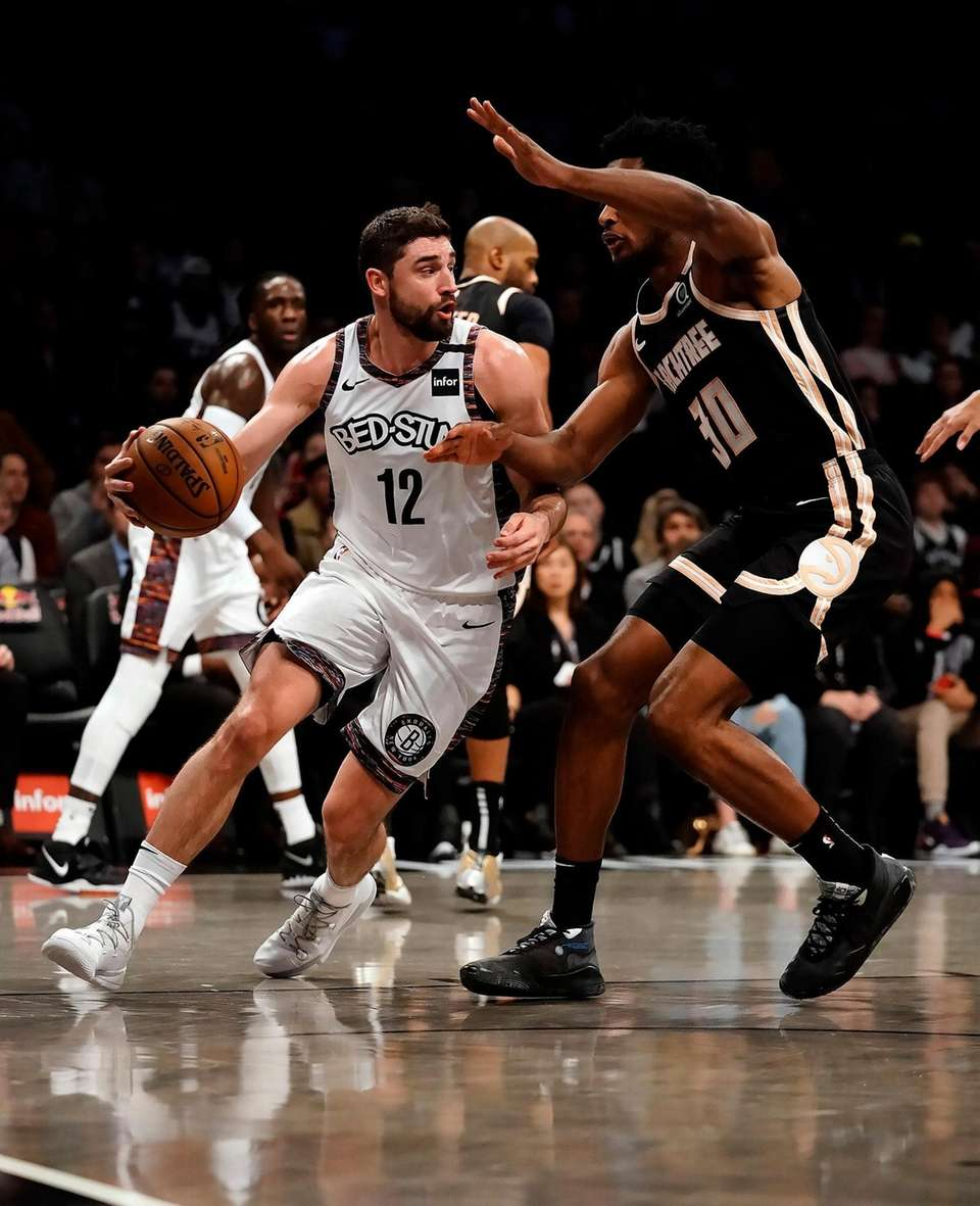 Brooklyn Nets guard Joe Harris (12) drives the