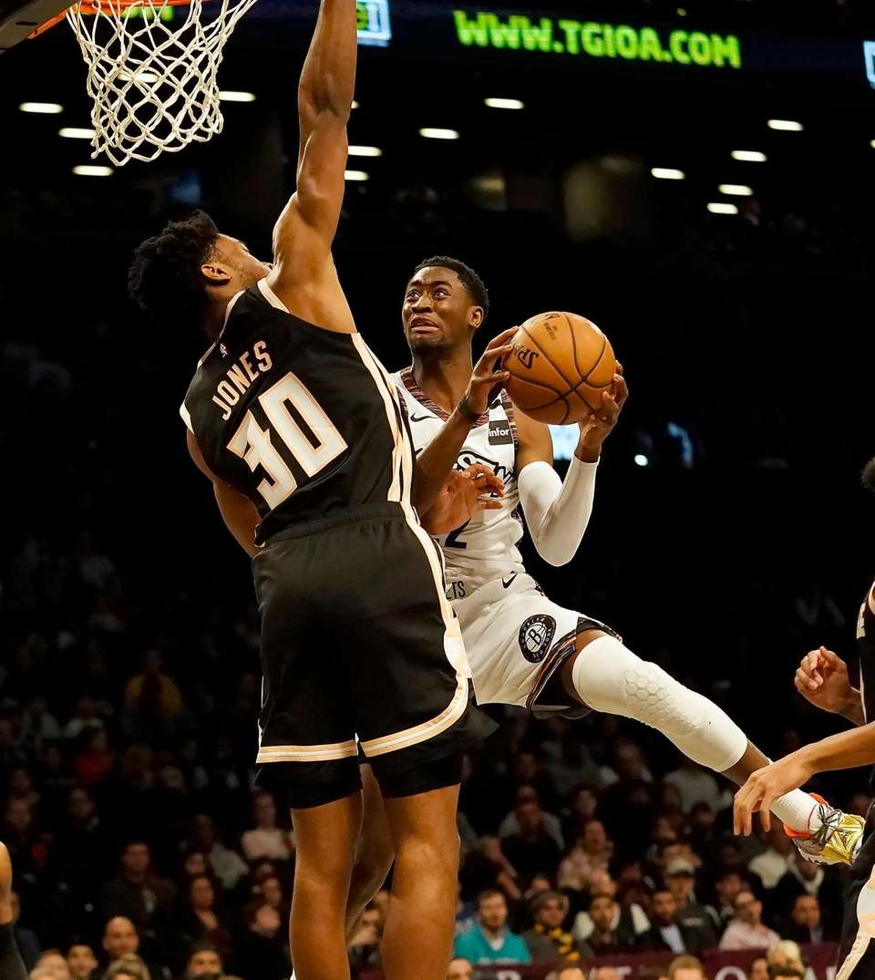 Brooklyn Nets guard Caris LeVert (22) drives to