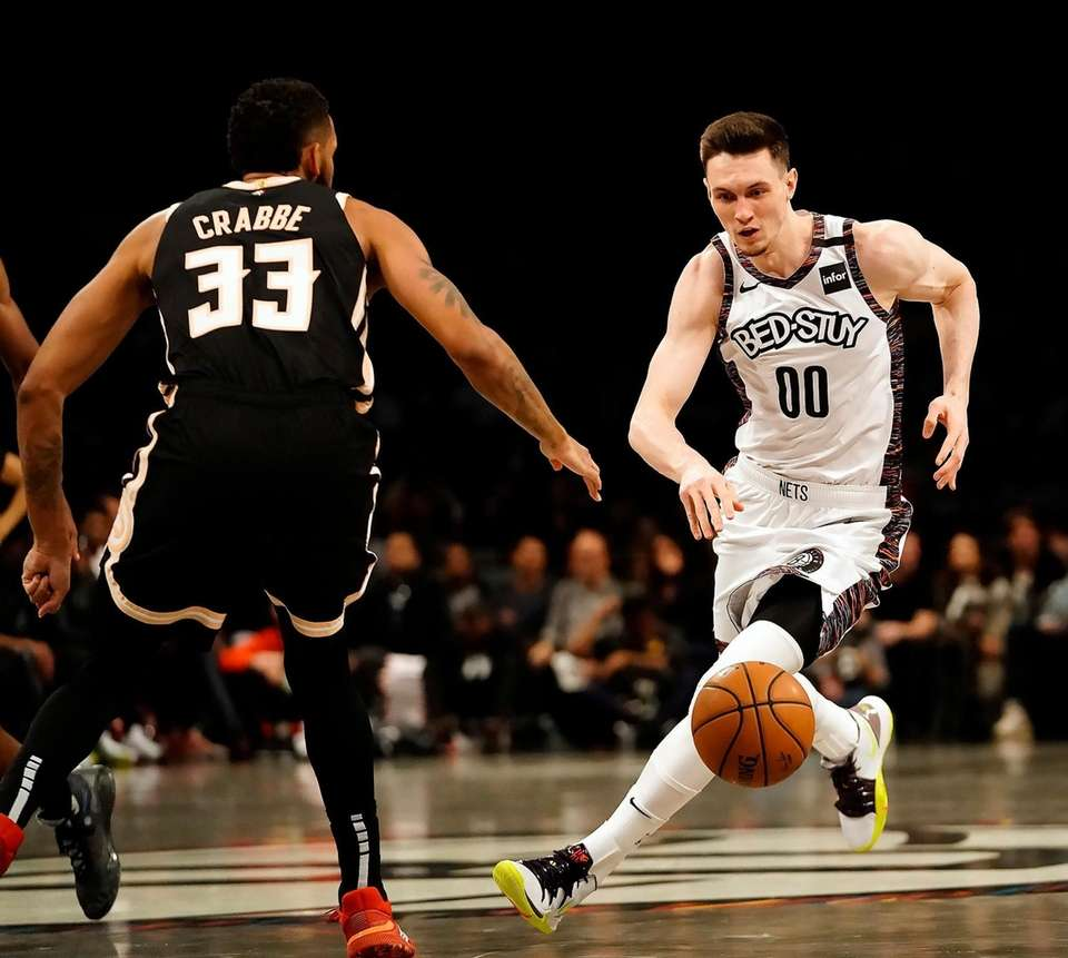 Brooklyn Nets forward Rodions Kurucs (00) drives around