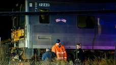 MTA Police officers and an LIRR worker investigate