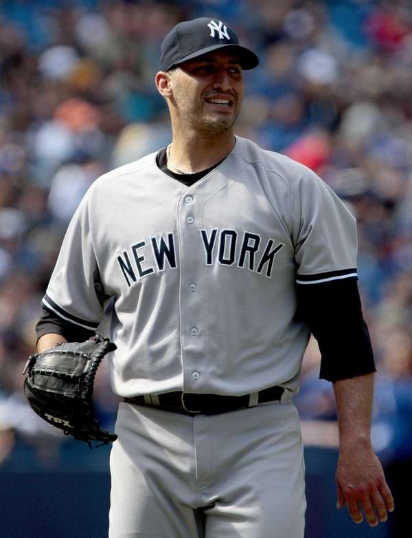 Andy Pettitte walks to the dugout in a